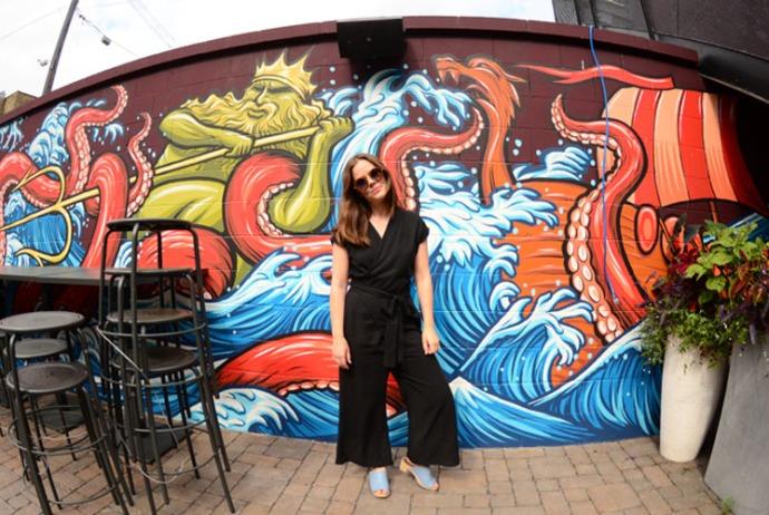 Hannah Jensen wearing a black jumpsuit