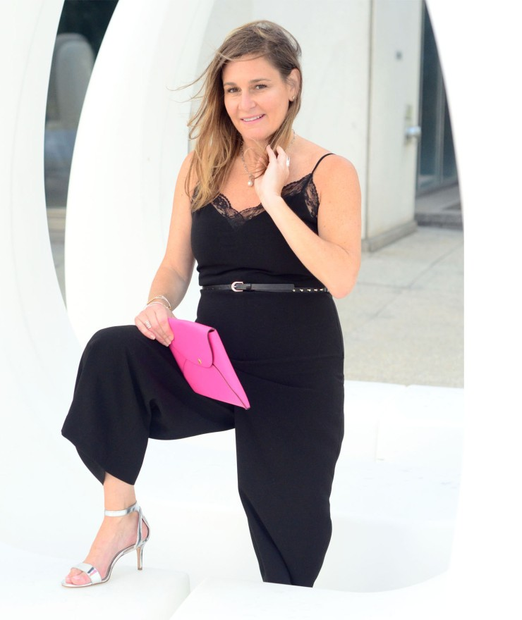 women-i-work-with-bethany-nagy-black-jumpsuit-pink-purse-silver-sandals