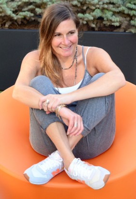 women-i-work-with-bethany-nagy-gray-jumpsuit-new-balance-sneakers-orange-chair