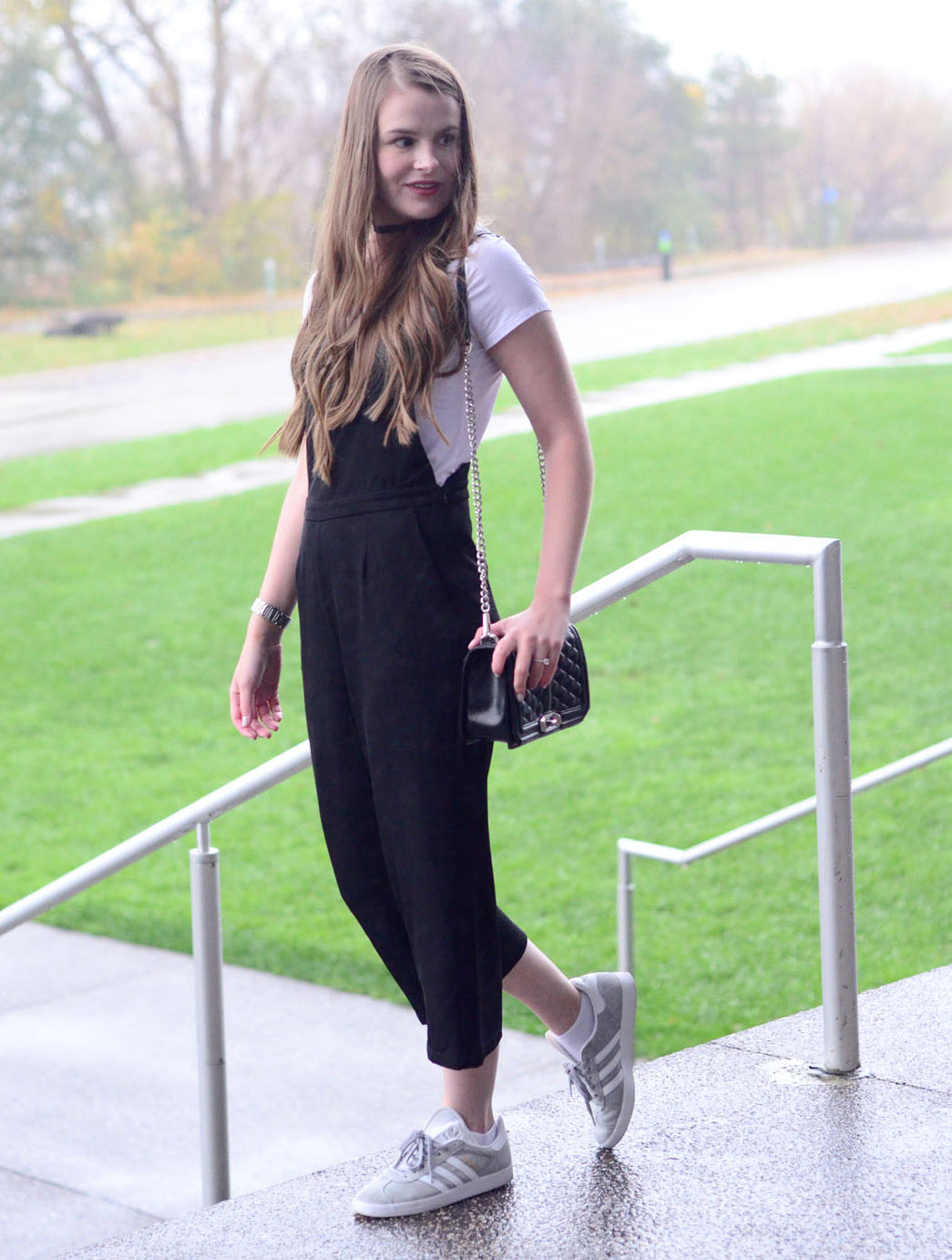 women-i-work-with-target-laura-anderson-black-jumpsuit-adidas-sneakers