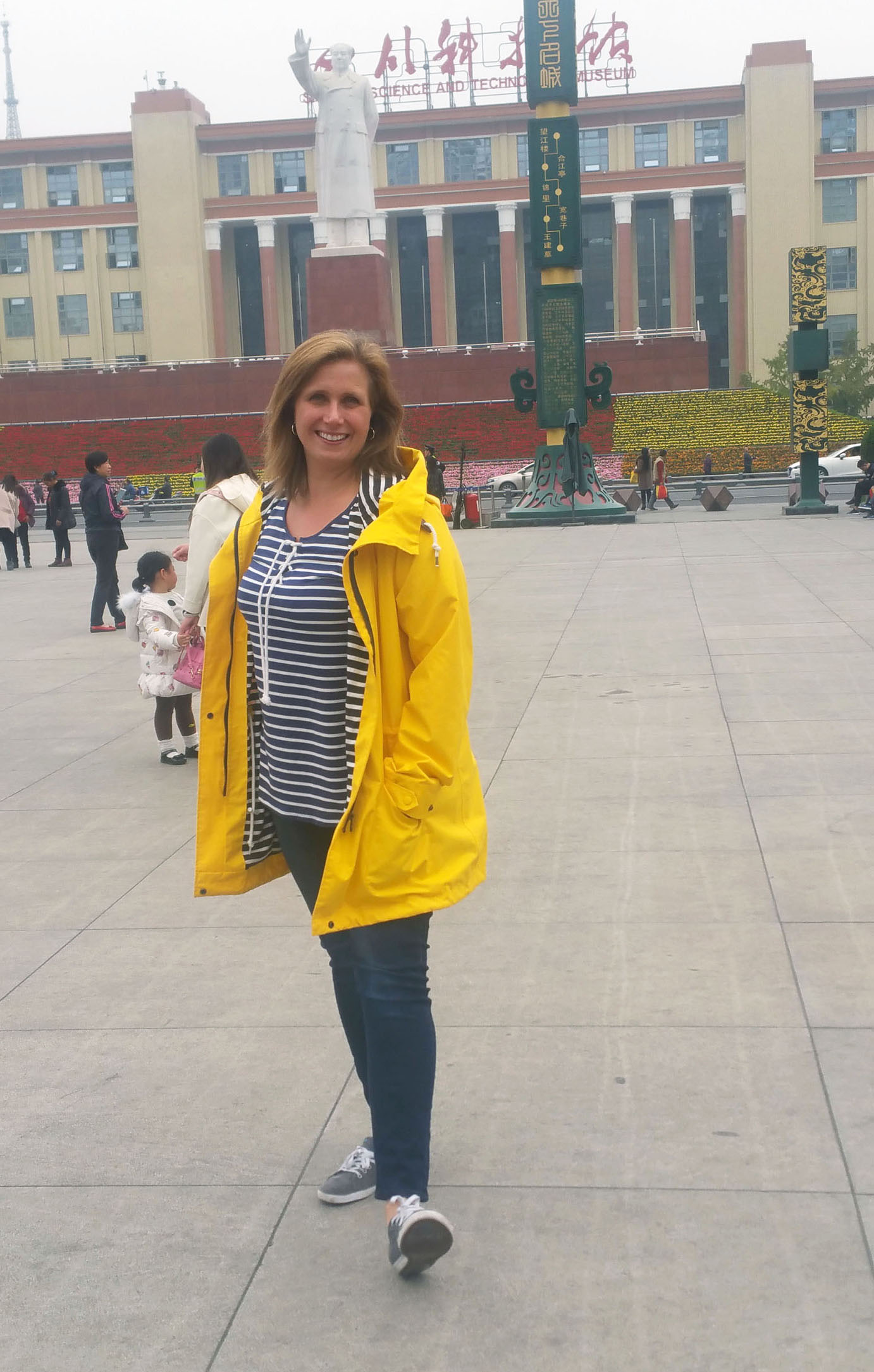 women-i-work-with-michelle-trombetta-china-yellow-raincoat-navy-stripe-top