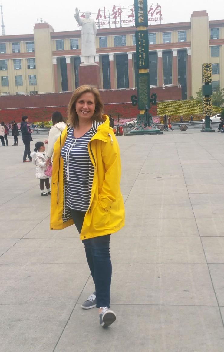 women-i-work-with-michelle-trombetta-china-yellow-raincoat-navy-stripe-top