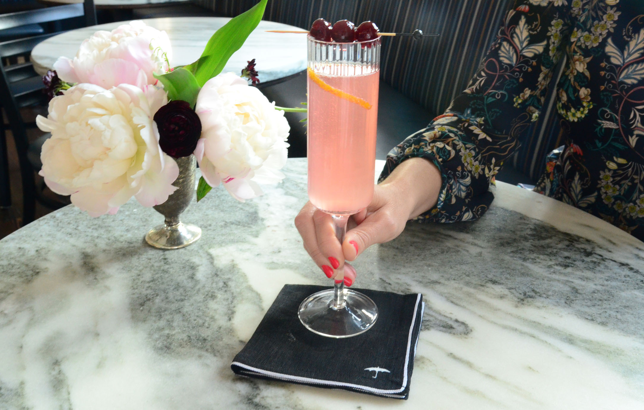 women-i-work-with-going-out-in-style-erin-furey-cassidy-iverson-champagne-cocktail-branded-napkin
