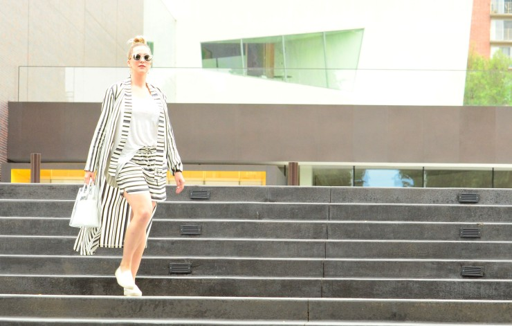 women-i-work-with-melissa-andrykowski-striped-shorts-striped-coat-white-sneakers-clear-bag